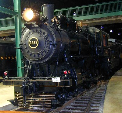 "PRR 1223 is a class D16sb American (4-4-0) built at the Pennsylvania  Railroad Juniata shops in 1905. Weighing 141,000 lbs, the coal-burner has  68"" drivers ..."